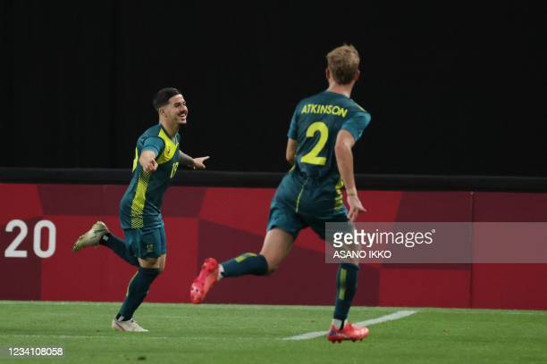 Australia's Marco Tilio celebrates scoring during the Tokyo 2020 Olympic Games men's group C first round football match between Argentina and...