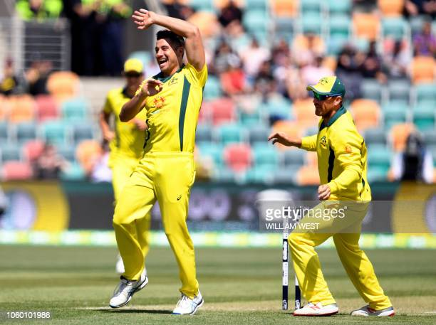 Australia's Marcus Stoinis celebrates with captain Aaron Finch after dismissing South Africa's batsman Reeza Hendricks during the third oneday...