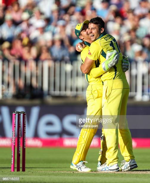 Australia's Marcus Stoinis celebrates with team mate Alex Carey after taking the wicket of England's Alex Hales during the Vitality IT20 Series match...