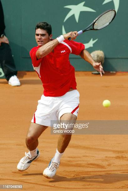 Australia's Mark Philippoussis powers a forehand return to Alan Mackin of Great Britain during their Davis Cup World Group first round tie in Sydney...