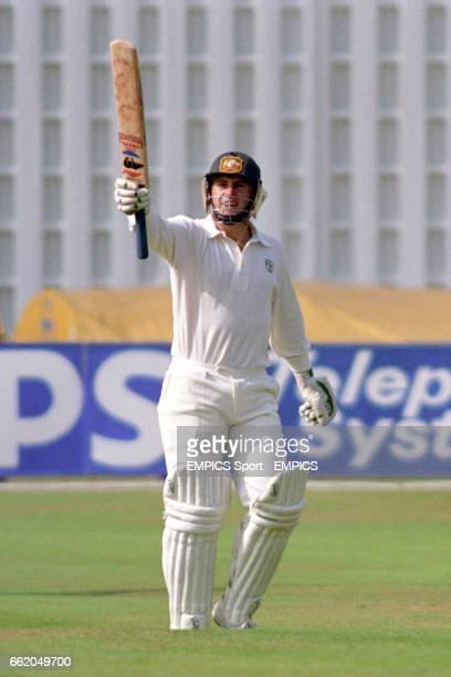 Australia's Mark Taylor celebrates reaching his century