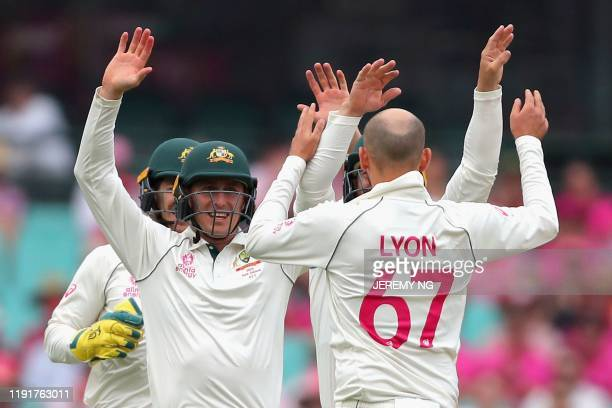 Australias Marnus Labuschagne and Nathan Lyon celebrate the wicket of New Zealand's Tom Blundell during the third day of the third cricket Test match...