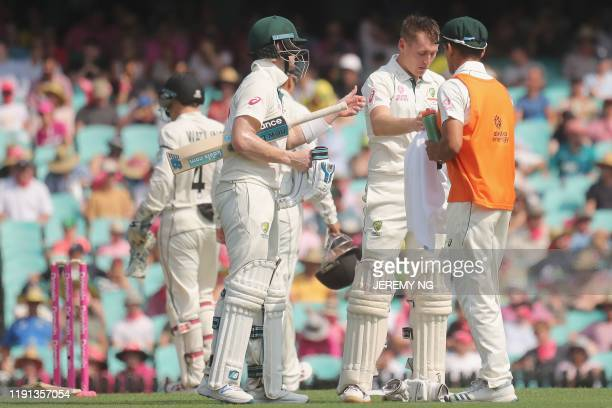 Australias Marnus Labuschagne and Steve Smith take a drinks break during the first day of the third cricket Test match between Australia and New...