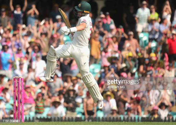 Australias Marnus Labuschagne celebrates scoring a century during the first day of the third cricket Test match between Australia and New Zealand at...