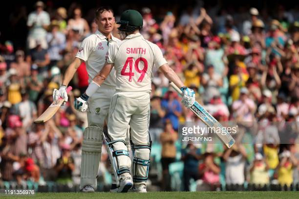 Australias Marnus Labuschagne celebrates scoring a century with Steve Smith during the first day of the third cricket Test match between Australia...