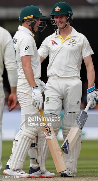Australia's Marnus Labuschagne reacts after being hit in the helmet by a ball bowled by England's Jofra Archer during play on the fifth day of the...