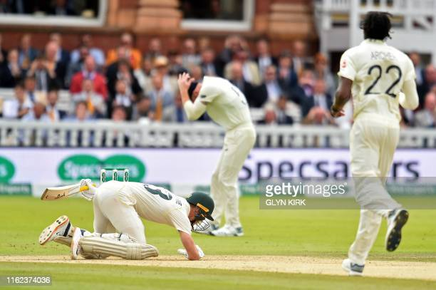 Australia's Marnus Labuschagne reacts after the ball, bowled by England's Jofra Archer hits him on the helmet during play on the fifth day of the...
