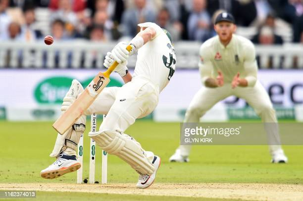 Australia's Marnus Labuschagne reacts as the ball, bowled by England's Jofra Archer hits him on the helmet during play on the fifth day of the second...