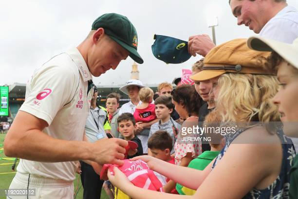 Australia's Marnus Labuschagne signs autographs after winning the third cricket Test match between Australia and New Zealand at the Sydney Cricket...