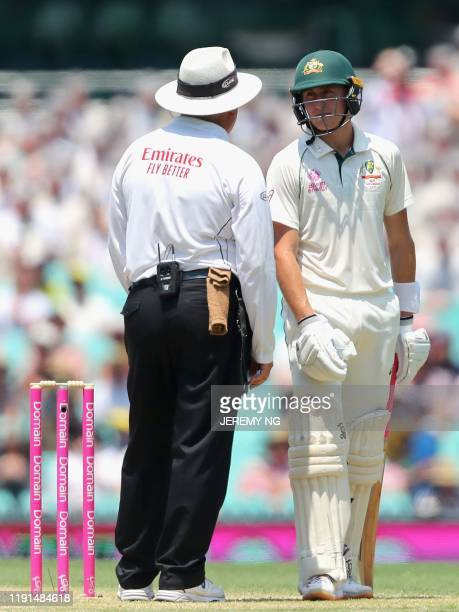 Australias Marnus Labuschagne speaks to umpire Marais Erasmus during the second day of the third cricket Test match between Australia and New Zealand...