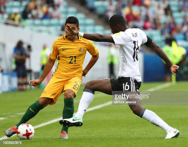 Australia's Massimo Luongo and Germany's Antonio Ruediger vie for the ball during the Confederations Cup group stages Group B match in the Fisht...