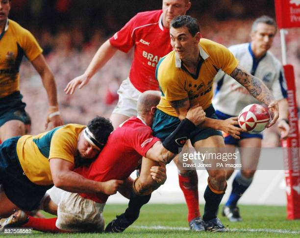 Australia's Mat Rogers is caught by Wales' Gareth Thomas during the International match at Millennium Stadium, Cardiff.