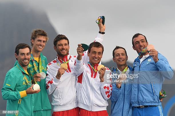 Australia's Mathew Belcher and Australia's Will Ryan Croatia's Sime Fantela and Croatia's Igor Marenic and Greece's Panagiotis Mantis and Greece's...
