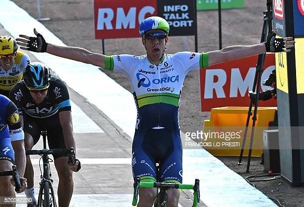 Australia's Mathew Hayman celebrates as he crosses the finish line and wins the 114th edition of the ParisRoubaix oneday classic cycling race between...