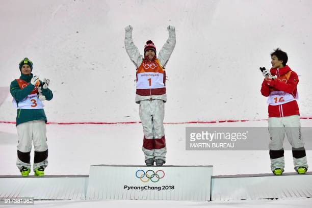 Australia's Matt Graham Canada's Mikael Kingsbury and Japan's Daichi Hara celebrate on the podium during the victory ceremony after the men's moguls...