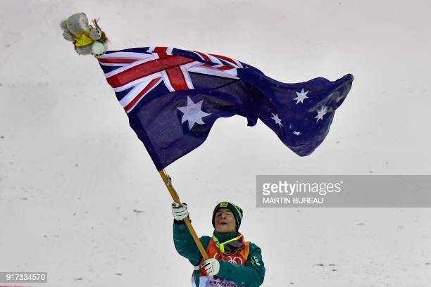 Australia's Matt Graham celebrates on the podium during the victory ceremony after the men's moguls final during the Pyeongchang 2018 Winter Olympic...