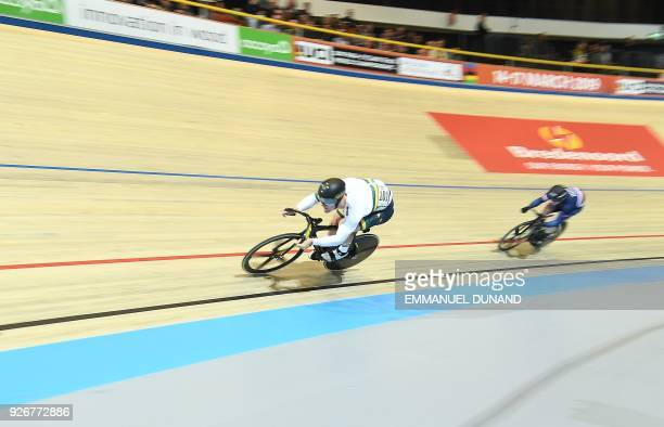 Australia's Matthew Glaetzer leads in front of France's Sebastien Vigier in the Men's Sprint semifinals during the UCI Track Cycling World...