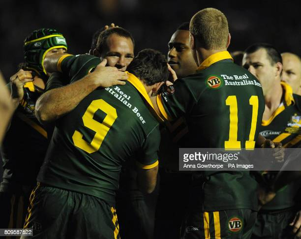 Australia's Matthew Scott celebrates his try with Cameron Smith during the Gillette Four Nations match at the Halliwell Jones Stadium Warrington