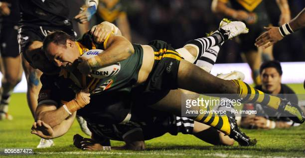 Australia's Matthew Scott scores his side's first try during the Gillette Four Nations match at the Halliwell Jones Stadium Warrington