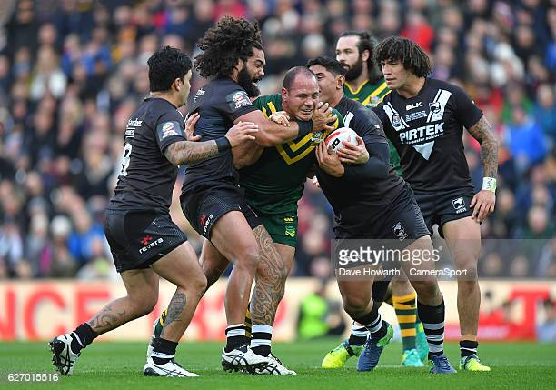Australia's Matthew Scott takes on the New Zealand defence during the Four Nations match between the New Zealand Kiwis and Australian Kangaroos at...