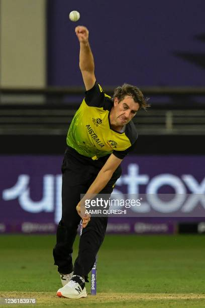 Australia's Matthew Wade delivers a ball during the ICC mens Twenty20 World Cup cricket match between Australia and Sri Lanka at the Dubai...