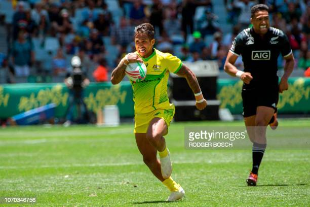 Australia's Maurice Longbottom runs for the try line during a quarterfinal rugby match between New Zealand and Australia on the second and last day...