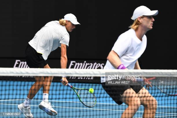 Australia's Max Purcell hits a return beside partner Australia's Luke Saville during their men's doubles final match against Rajeev Ram of the US and...