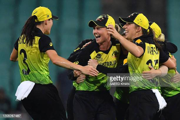 Australia's Meg Lanning and her teammates celebrate after winning against South Africa during the Twenty20 women's World Cup semi-final cricket match...