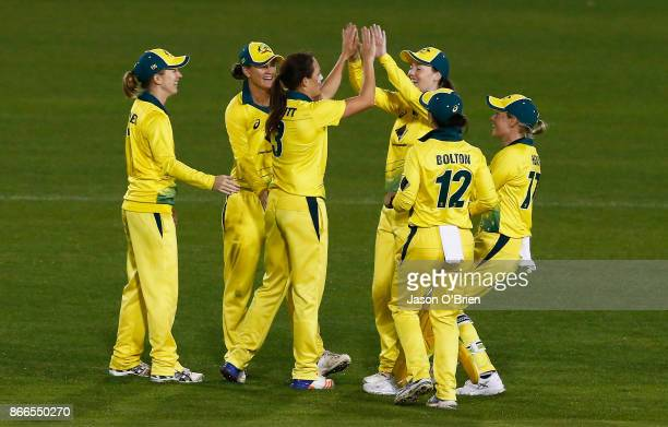 Australia's Megan Schutt celebrates taking the wicket of Tammy Beaumontduring the Women's One Day International match between Australia and England...