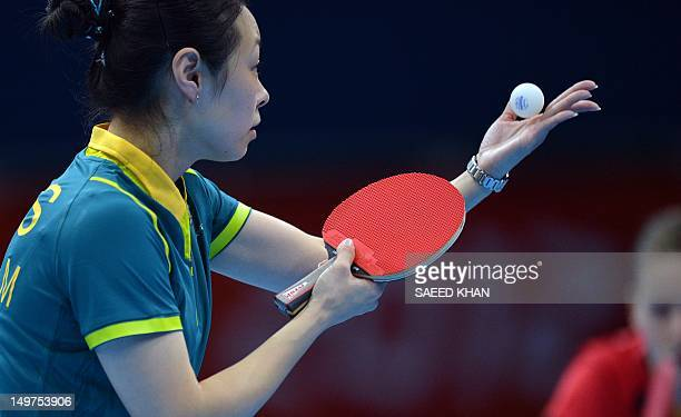 Australia's Miao Miao serves to Irene Ivancan of Germany during a table tennis women's team match of the London 2012 Olympic Games at the Excel...
