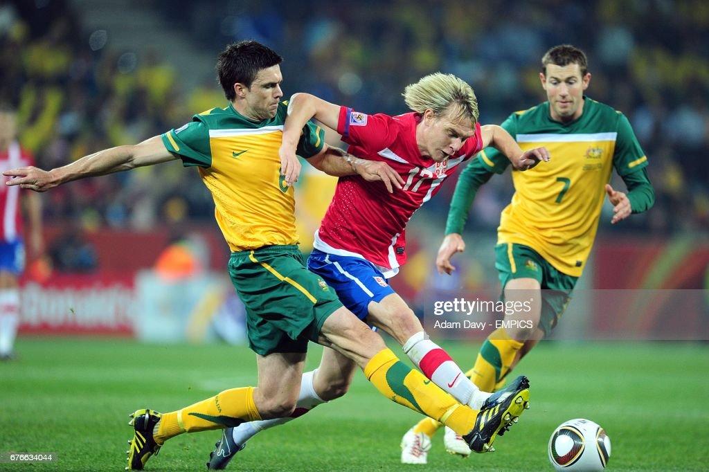 Australia's Michael Beauchamp (left) and Serbia's Milos Krasic (centre) battle for the ball