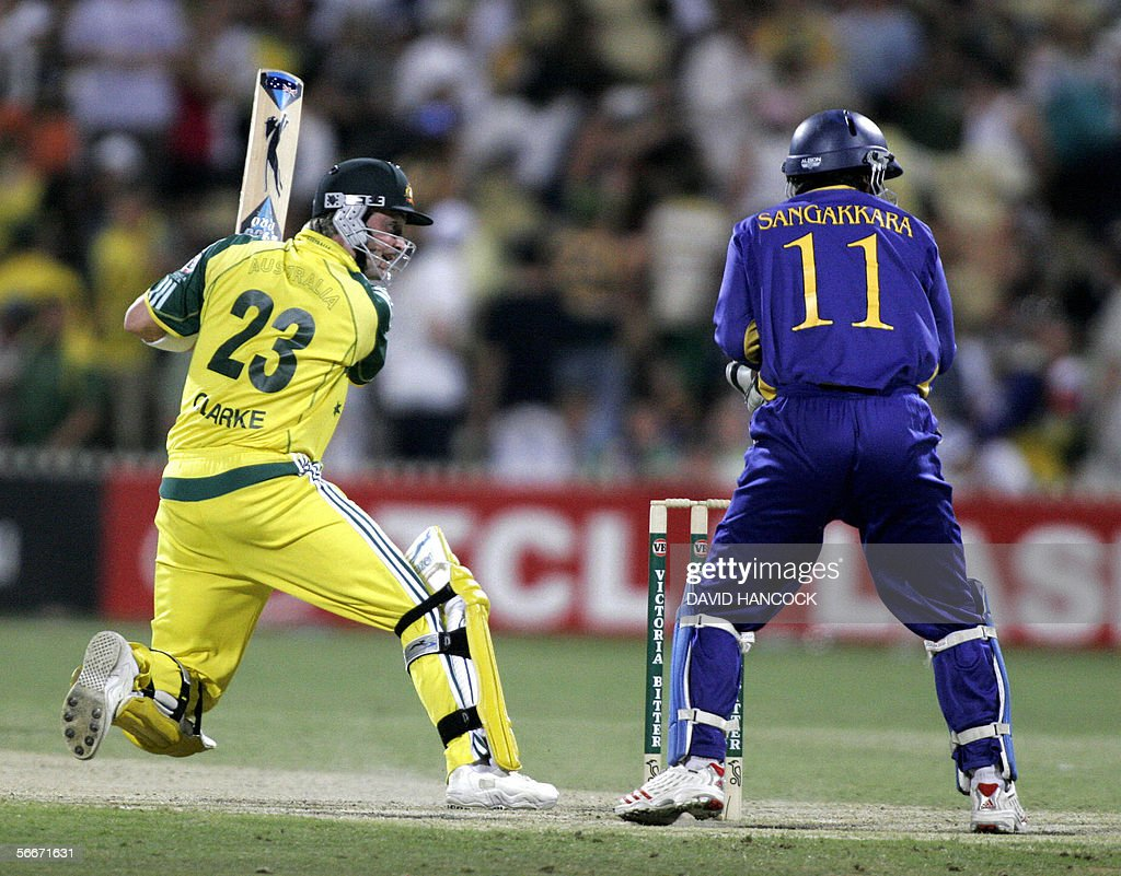 Australia's Michael Clarke (L) cuts a ball as Sri Lankan wicket-keeper Kumar Sangakkara (R) looks on in a One Day International match won by Australia at the Adelaide Oval 26 January 2006. Australia won the match 5-219 beating Sri Lanka's total of 218. Australia now leads the competition on 14 points with Sri Lanka on 9 and South Africa on 8.