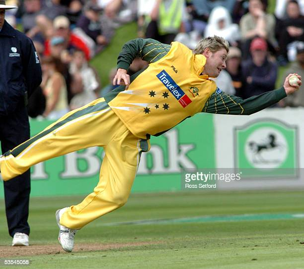 Australia's Michael Clarke makes a diving catch to dismiss New Zealand's Hamish Marshall for 23 in the fourth one day international cricket match at...