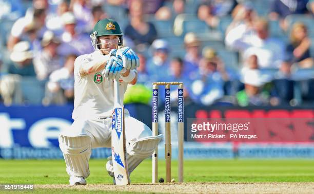 Australia's Michael Clarke stretches after a shot during day one of the Third Investec Ashes test match at Old Trafford Cricket Ground Manchester