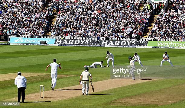 Australia's Michael Clarke watches from his crease as England's Adam Lyth catches him out for three runs on the second day of the third Ashes cricket...