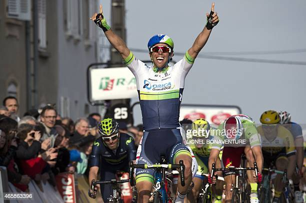 Australia's Michael Matthews celebrates as he crosses the finish line at the end of the third stage of the 73rd edition of the ParisNice cycling race...