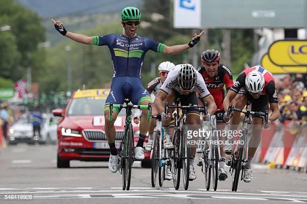 Australia's Michael Matthews celebrates as he crosses the finish line ahead France's Samuel Dumoulin, Slovakia's Peter Sagan, Belgium's Greg Van...