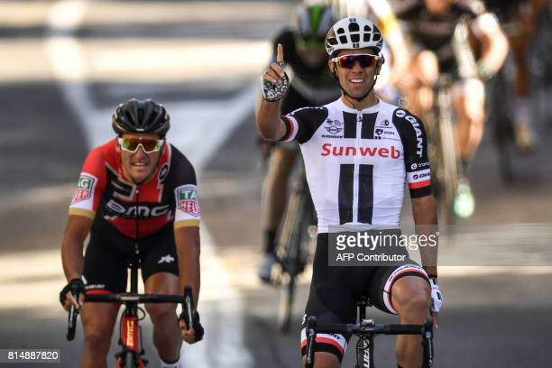 Australia's Michael Matthews celebrates as he crosses the finish line ahead of Belgium's Greg Van Avermaet at the end of the 1815 km fourteenth stage...