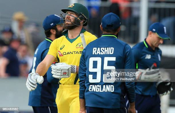 Australia's Michael Neser reacts after losing his wicket for two runs from a catch by England's Jos Buttler on the fourth One Day International...
