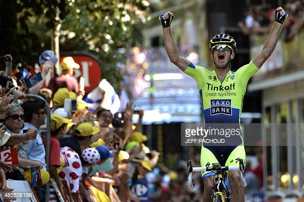 Australia's Michael Rogers celebrates as he crosses the finish line at the end of the 2375 km sixteenth stage of the 101st edition of the Tour de...