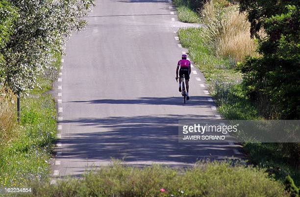 Australia's Michael Rogers rides in the countryside of Gap during a training session in a rest day in the 93rd Tour de France cycling race 17 July...