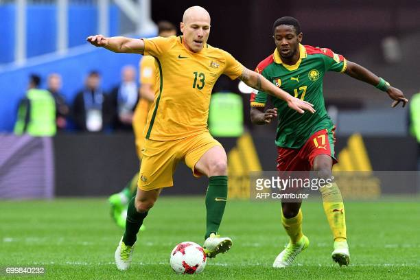 Australia's midfielder Aaron Mooy vies for the ball against Australia's midfielder Ajdin Hrustic during the 2017 Confederations Cup group B football...