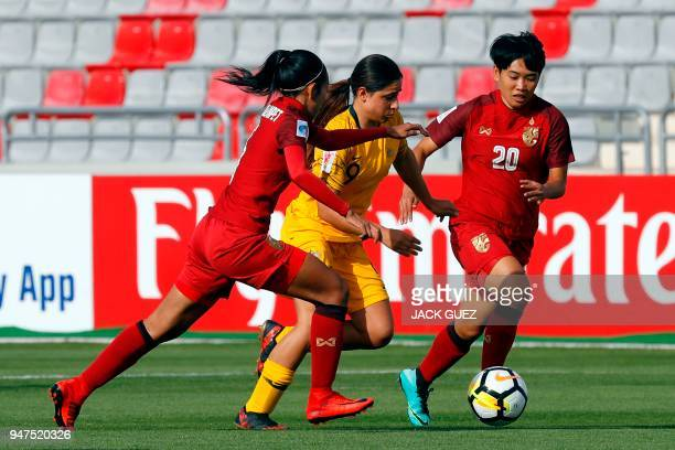 Australia's midfielder Alex Chidiac vies for the ball with Thailand's midfielder Pikul Khueanpet during the AFC Women's Asian Cup Semi Final match...