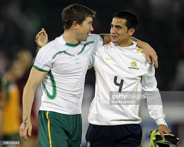 Australia's midfielder Harry Kewell and striker Tim Cahill celebrate after beating Iraq in their 2011 Asian Cup quarter-final football match at...