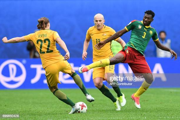 Australia's midfielder Jackson Irvine vies for the ball against Cameroon's midfielder Andre Zambo during the 2017 Confederations Cup group B football...