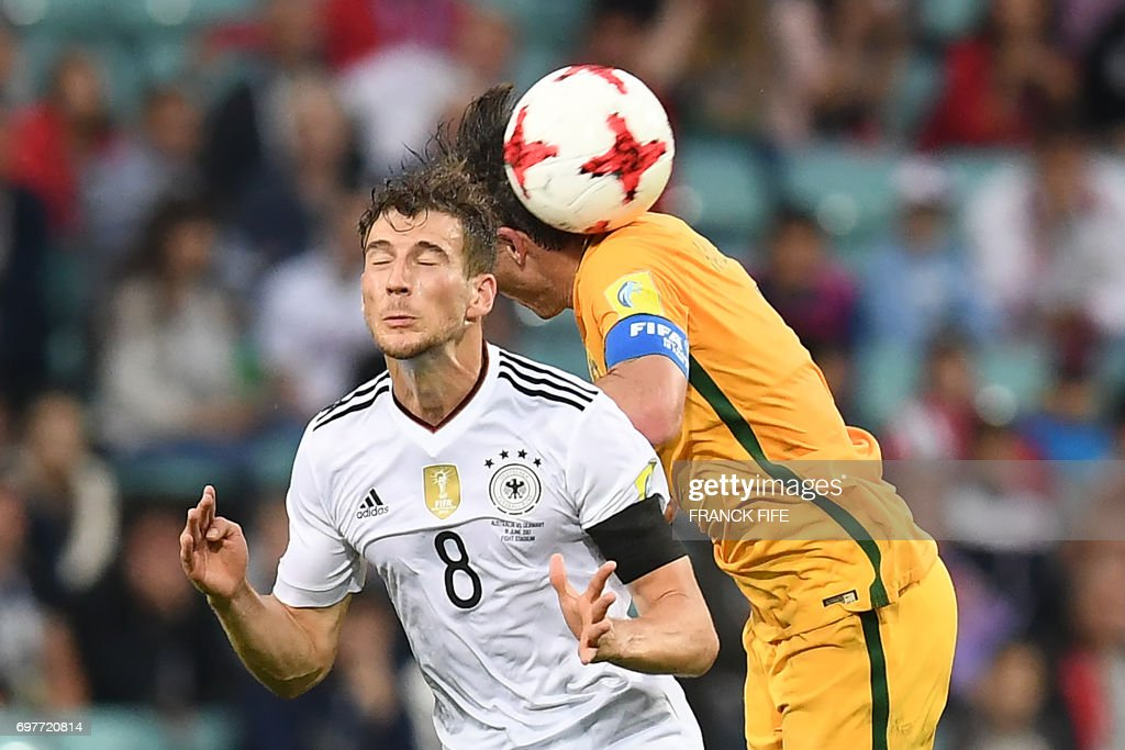 Australia's midfielder Mark Milligan (R) jumps for the ball against Germany's midfielder Leon Goretzka during the 2017 Confederations Cup group B football match between Australia and Germany at the Fisht Stadium in Sochi on June 19, 2017. /