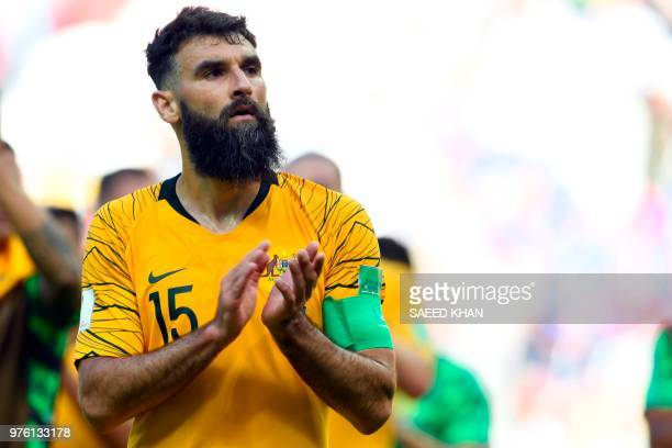 Australia's midfielder Mile Jedinak applaud their fans after being defeated by France at the end of the Russia 2018 World Cup Group C football match...