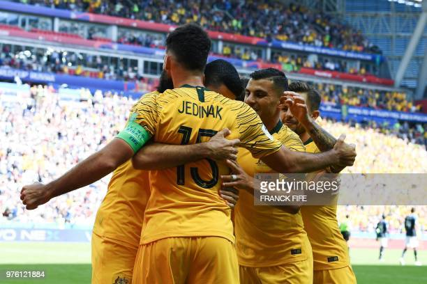 TOPSHOT Australia's midfielder Mile Jedinak celebrates a goal with teammates during the Russia 2018 World Cup Group C football match between France...