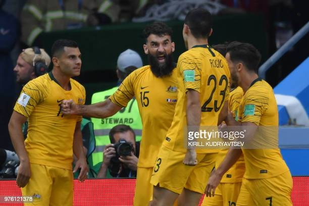 TOPSHOT Australia's midfielder Mile Jedinak celebrates after scoring a penalty to tie the game during the Russia 2018 World Cup Group C football...