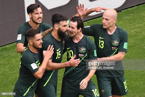 TOPSHOT Australia's midfielder Mile Jedinak celebrates with teammates after scoring a penalty kick during the Russia 2018 World Cup Group C football...